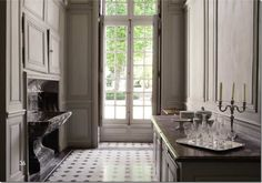 Butlers pantry Chateau de Montgeoffroy. The gray paint, marble, tile floors and the windows!