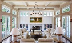 In the living room, daylight streams in from the French doors and clerestory windows that surround the space. Cottage Living Rooms, House Rooms, Home Living Room, Living Room Designs, Unique Living Room Furniture, Small Country Homes, Family Room Addition, French Country Living Room, Home Fix