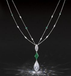 A MAGNIFICENT DIAMOND AND EMERALD PENDENT NECKLACE  Suspending a briolette diamond weighing approx 31.92 carats,