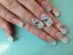 One stroke freehand flower nail art over acrylic nails