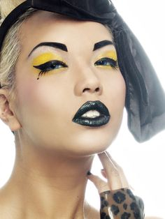 Amazing. Black lips with bumblebee yellow eye makeup. Love the black nails too.