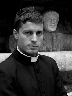 """Roman Catholic priest in the Vatican, photographed for the annual """"Roman Priest Calendar"""", which is sold on the streets of Rome to tourists. - Photo by Piero Pazzi, found via Buzzfeed"""