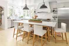 Two shades of white, Benjamin Moore's Winter White and Gray Owl, combine to wrap this kitchen in a soothing vibe.    See more of thisCalm