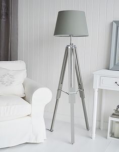 Grey and white living room home accessories. Grey tripod floor lamp
