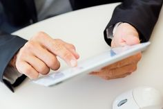 closeup portrait of office worker hands with tablet Free Photo