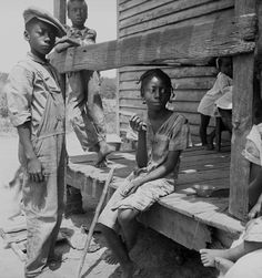 African American farm children on the porch of their home in the Mississippi Delta. Photo by Dorothea Lange, June 1936.