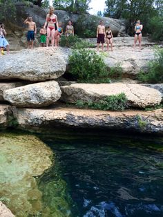 Jumping off the rock at Jacobs well in Wimberly Texas