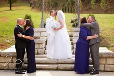 idea for wedding photos with parents, bride and groom kissing, parents of bride and groom kissing, The Barn at Chestnut Springs, blue and white wedding, Coast Guard Wedding, Jaclyn Paige Photography