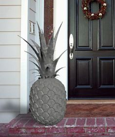 Decorative Stone Pineapple to welcome you home.