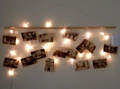 my DIY wall decor! Made using ikea Christmas lights, a wooden stick, vintage styled postcards, 2 nails, and white string!