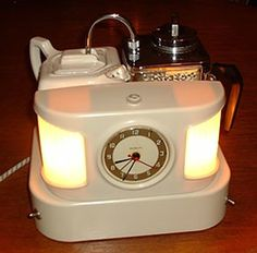 English in white BakeliteTeasmade 1960 This Teasmade is for sale in perfect condition  at Timemaster.nl in the Netherlands
