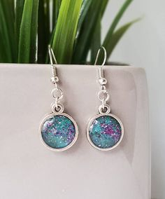 Hey, I found this really awesome Etsy listing at https://www.etsy.com/uk/listing/496087851/turquoise-glitter-earrings-glitter