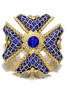 An eighteen karat gold and enamel brooch, David Webb designed as a blue enamel Maltese cross, enhanced by textured gold detail, centering a blue enamel dome within a hammered gold foliate surround; signed Webb; gross weight approximately: 80.0 grams; diameter: 2 1/4in