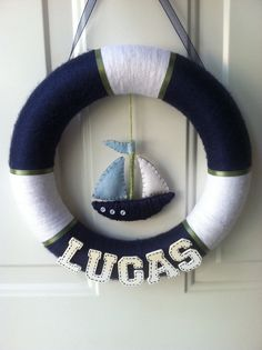 How cute is this Brittany Buckley - I think you should come up with a cute one for Abby. (Not so much nautical though) Nautical wreath for boy nursery. Maybe with a starfish instead of that boat-thing - Baby Nursery Today Nautical Nursery, Nautical Theme, Sailor Theme Nursery, Sailboat Nursery, Baby Boy Rooms, Baby Boy Nurseries, Deco Marine, Nautical Wreath, Baby Room Decor