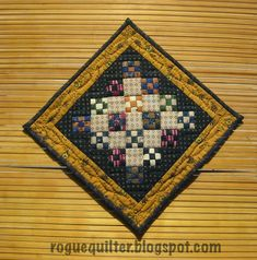 """""""Tiny Nines"""" is a finish! I machine quilted the center in a simple crosshatch and hand quilted a narrow cable in the border. This finishes at 7"""" square. The 9-patches finish at 3/4""""."""