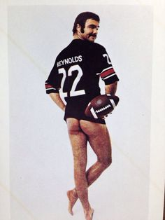 Sticker featuring Burt Reynolds in his day. 1972 football jersey referencing the year the photo taken. Approx. 3 x 4.5