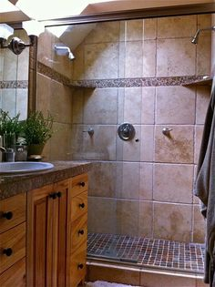 Bathroom tiles and shelves. units close to shower