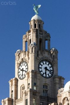 The clock tower on top of the Liver Building at Pier Head in Liverpool, Merseyside, England - photo by David Clapp, via Corbis