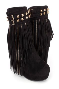 These sexy and stylish platform wedge booties feature a faux suede upper with a strappy ankle design and pyramid studded detailing, buckle accent, fringe trim with beaded chain dangle design, stitched trim, inner side zipper closure, round closed toe, smooth lining, and cushioned footbed. Approximately 5 inch wedge heels and 1 1/2 inch platforms.http://www.amiclubwear.com/chunky-heels.html