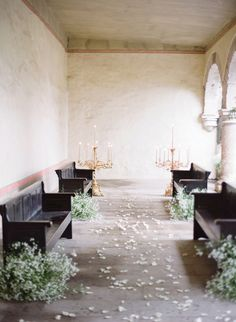 Rustic aisle with pews and baby's breath