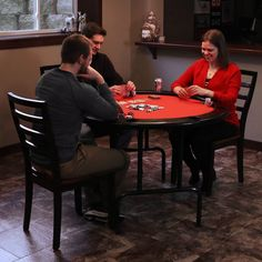 Have the perfect place to play your favorite card or board games for your next game night on the Sunnydaze Folding Round Poker Table. This table comfortably accommodates 6 players and features built-in cup holders with removable plastic liners so they are easy to clean. The perimeter of the table features a padded rail, so you can play in ultimate comfort. A soft, red felt cloth covers the playing surface of the table and is the perfect texture for cards.