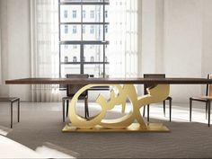 Inspired by traditional arabesque patterns, the table boasts intricate woodwork repetitions of the word 'Salam', Arabic for 'peace'. The pattern has been constructed closely enough to block any cutlery from passing through the table. Table Furniture, Home Furniture, Furniture Design, Arabesque, Islamic Wall Decor, Islamic Art, Decoration, Bronze, Interior Design