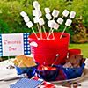 Almost as American as apple pie, s'mores are the perfect ending for your patriotic party. Instead of making guests juggle marshmallow bags and graham crackers around the fire pit, set up a s'mores bar to serve individual ingredients in a far more civilized fashion. Don't forget the napkins – s'mores are messy!  Shop 4th of July Party Food Ideas