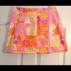 Like new Lilly Pulitzer skirtFinal price Really pretty Lilly Pulitzer skirt in new condition! Only worn about 2 times. Combination of yellow, pink and orange colors perfect for spring and summer. Shorts on the inside. Measures at 14.5 inches long. Lilly Pulitzer Skirts