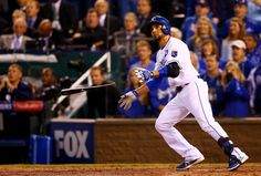 Omar Infante of the Kansas City Royals hits a two-run home run in the sixth inning against San Francisco Giants during Game Two of the 2014 World Series at Kauffman Stadium on October 2014 in. Get premium, high resolution news photos at Getty Images Kc Royals Baseball, Pro Baseball, 2014 World Series, Kansas City Royals, Best Series, World Of Sports, San Francisco Giants, Things That Bounce, Running