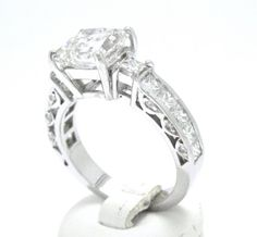 18K white gold, 3.08CTW princess and round cut diamonds... don't need all that I just like the style