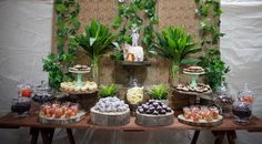 Create a classic jungle baby shower with tree slices/candy jars/jadeite cake stands/wooden cake stands and loads of greenery and layering  all available at My Sweet Event in Melbourne