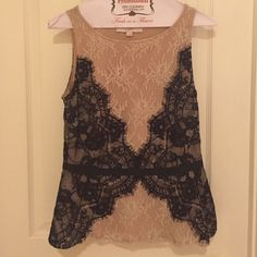 Ann Taylor LOFT lace top Beautiful cream & black lace top. Black ribbon around the waist with bow detail on the back. Side zip closure. Like new, worn twice. LOFT Tops