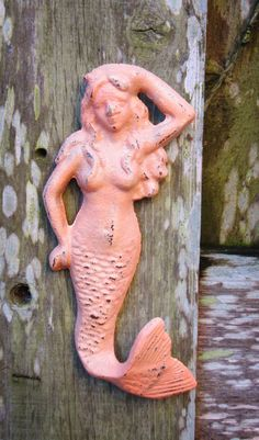 Hey, I found this really awesome Etsy listing at https://www.etsy.com/listing/179922837/mermaid-wall-hook-peach-coral-beach
