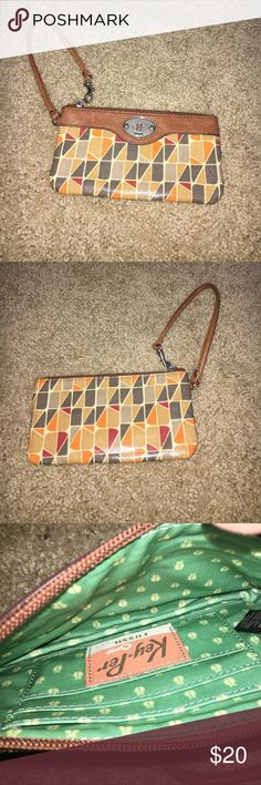 Fossil Wristlet Fossil Wristlet patterned in orange grey tan and yello with leather top. Inside real pattern. Small pen dot on front, otherwise in great condition. Real leather for the top. Bottom is a durable textile. Fossil Bags Clutches & Wristlets