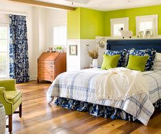 A bold palette of #navy blue, lime #green, and white helps this #bedroom strike a balance between traditional and modern