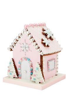 Inspired by the pretty pastel coloured houses found in West London, this luxury candy coloured gingerbread house is sure to delight anyone who sets eyes on it. With a heavenly scent of sugar and spice, each house has been painstakingly iced to perfection Cool Gingerbread Houses, Christmas Gingerbread House, Christmas Treats, Gingerbread Cookies, Pink Christmas Decorations, Barn Wedding Decorations, Biscuit Decoration, Peggy Porschen Cakes, Ballerina Cakes