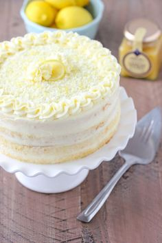 Limoncello Cake - Olga's Flavor Factory This Limoncello Cake is made with fluffy sponge cake layers, brushed with a limoncello syrup, filled with a thin layer of lemon curd and frosted with a decadent mascarpone and cream cheese frosting. Lemon Desserts, Köstliche Desserts, Lemon Recipes, Baking Recipes, Delicious Desserts, Cake Recipes, Dessert Recipes, Plated Desserts, Lemoncello Dessert