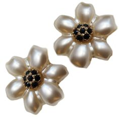 "These iridescent pearl flower earrings are accented with a crystal center.   1.25"" Length  Resin, Crystal, 24 Karat Clad Base Metal  Nickel and Lead Free  This item may also be special ordered using our custom color chart.  Made in Italy"