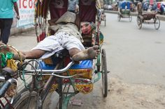 Man sleeping in his rickshaw on a street in Dhaka, Dhaka Street Photography, Dhaka, Bangladesh, Indian Sub-Continent, Asia
