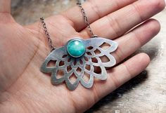 Reserved for the loveliest of them all, Miss Renee!  Please do not purchase unless you are she- Thank you so much!!      A hand pierced sterling plate that resembles a gorgeous dahlia bloom and a petite aqua blue Amazonite cabochon pair up in this simple stunner of a necklace. A lovely oxidized textured sterling cable chain suspends the pendant around your neck. As a perfect finishing touch, the extender is accented by a solitary Sleeping Beauty turquoise briolette. All silver has been…