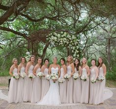 Bridesmaids in Long Champagne Colored Strapless Dresses