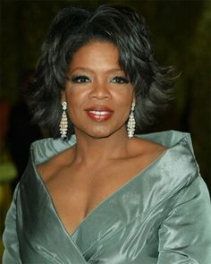 I like this look in Oprah; I think green is her color and the hairstyle is really soft and classy.