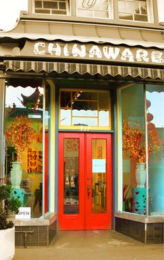 love the red doors. going to paint the doors of our market this color this weekend!