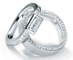 PLATINUM AND DIAMOND RINGS BY HENRICH & DENZEL