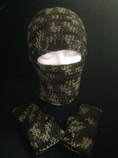 Crochet Camo full face hat/ski mask and fingerless gloves. I used this quick pattern for the gloves http://www.tangledhappy.com/2014/01/valentine-mitts.html?m=1 I had to use the teen size for my little 8yr old. I crochet tight though, so, maybe that is why.
