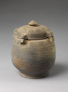Covered Urn Period: Unified Silla dynasty (668–935) Date: 8th century Culture: Korea Medium: Stoneware with stamped decoration Dimensions: H. 8 1/2 in.(23.2 cm) Classification: Ceramics Credit Line: Purchase, Lila Acheson Wallace Gift, 1997 Accession Number: 1997.34.16a, b On view in Gallery 233 ~The custom of cremation is associated with buddhism, and the prevalence of such urn signals the growing popularity of the religion in Korea.