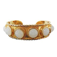 Chanela Baroque Moonstone Cabochon Glass Cuff Bracelet | From a unique collection of vintage bangles at http://www.1stdibs.com/jewelry/bracelets/bangles/
