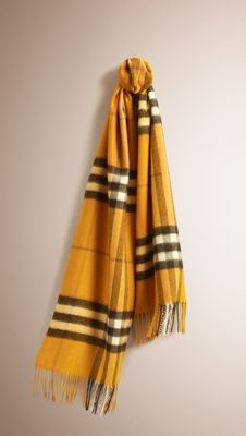 Yellow scarf from Burberry. Works very well during autumn.