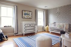 Mandarina Studio | Boston | Nursery | Interior Design | Contemporary | Baby Room | Boys Nursery | Blue Striped Rug | White Book Shelf | White Knitted Pouf | Draperies | Neutral/ Tan Bedroom | White and Blue Bedroom