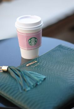 Pink Starbucks and a monogrammed clutch? Yes please.